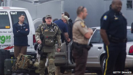Law-enforcement officials look at an Alabama bunker where a boy was held