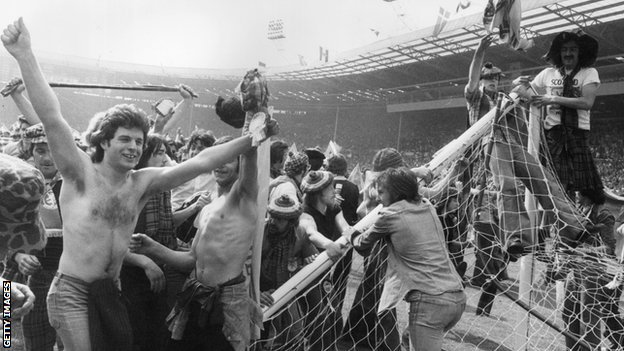 Scotland fans on the Wembley pitch in 1977