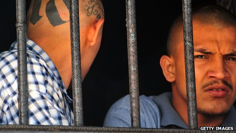 Inmates behind bars at the prison of San Pedro Sula in Honduras