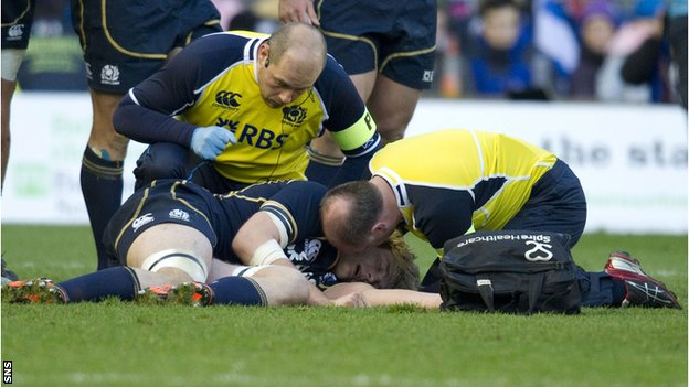 Scotland's Richie Gray receives treatment