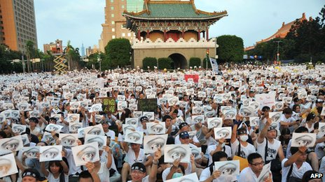 Protesters hold placards at an anti-military rally in front of Taiwan's presidential office in Taipei