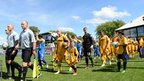 Newport County and Accrington Stanley players are led out onto the Rodney Parade pitch ahead of the home side's return to the Football League after a 25-year absence.