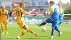 Newport County's Christian Jolley battles for the ball with Accrington Stanley's Michael Liddle on the opening day of the League Two season.