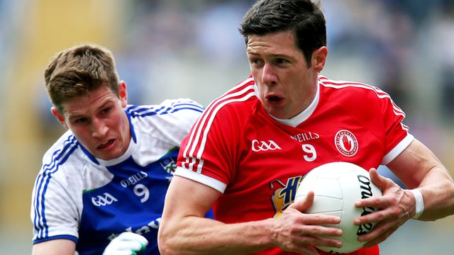 Monaghan's Darren Hughes in action against Tyrone's Sean Cavanagh