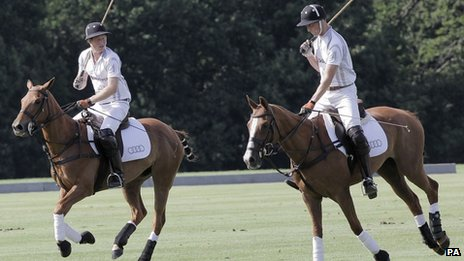 The Duke of Cambridge and Prince Harry playing a charity polo match at the Audi Polo Challenge, at Coworth Park, Berkshire