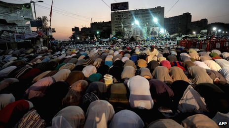 Supporters of the deposed president Mohammed Morsi perform evening prayer at Rabaa al-Adawiya square in Cairo
