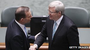 Australian PM Kevin Rudd (r) shakes hands with opposition leader Tony Abbott (l) on 27 June 2013