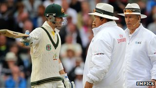 Michael Clarke and the umpires