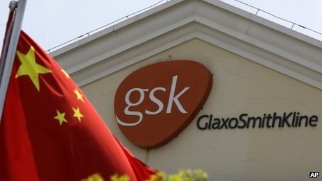 A Chinese flag is hoisted in front of the GlaxoSmithKline building in Shanghai, China, 24 July 2013