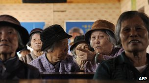 File photo: elderly women in a tea house in Chengmai city, in China's southern Hainan province, 22 January 2013