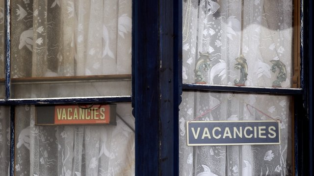 Vacancies signs in a window