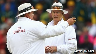 Umpires Marais Erasmus and Tony Hill