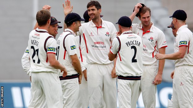 Kyle Hogg (centre) celebrates with Lancashire team-mates