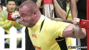 Mariusz Pudzianowski of Poland with a strained face as he lift heavy weights
