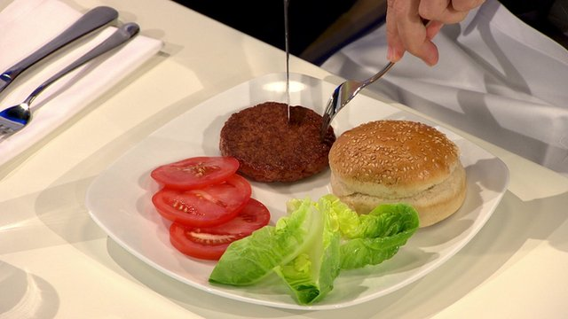 A food critic cuts into the world's first lab-grown burger