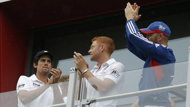 England's Alastair Cook, Jonny Bairstow and Matt Prior applaud the crowd