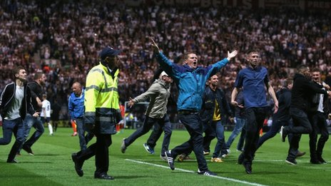 Fans invade the Deepdale pitch