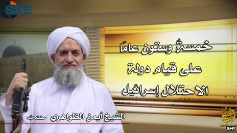 "Image of Ayman al-Zawahiri released by al-Qaeda on 6 June 2013. Arabic says: ""Sixty-five years since the establishment of the state of occupation Israel"""