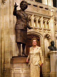 Margaret Thatcher in front of a bronze statue of herself, inside the Palace of Westminster, on 21 February 2007