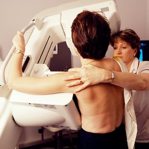 Woman having mammogram