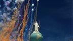 Fireworks go off around a statue of San Salvador's patron saint