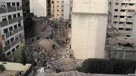 Rubble left by collapsed building. 6 Aug 2013
