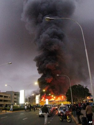 Dense black smoke billows from the Jomo Kenyatta International Airport in Nairobi, Kenya, early on Tuesday