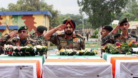 Indian army chief General Bikram Singh with the coffins of the killed soldiers in Jammu on 7 Aug 2013