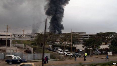 Dark smoke rises from the Jomo Kenyatta International Airport in Nairobi, Kenya, on Wednesday