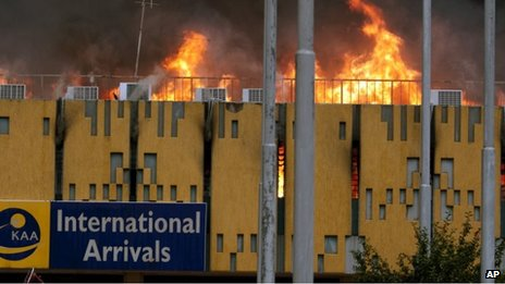 A blaze rages the arrivals hall at the Jomo Kenyatta International Airport in Nairobi, Kenya on Wednesday