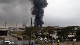 Dark black smoke rises from the Jomo Kenyatta International Airport in Nairobi, Kenya, Wednesday, Aug. 7, 2013.