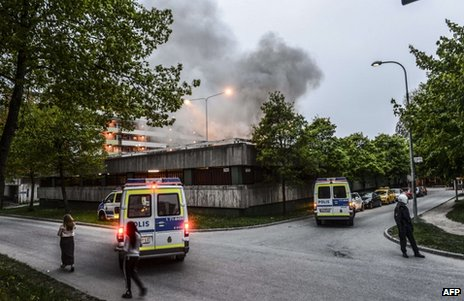 Police secure an area of Husby, Stockholm, during rioting, 20 May