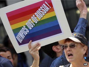 A gay rights activist holds up a placard during a demonstration in front of the Russian consulate in New York on 31 July