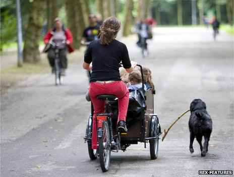 Woman with children in cargo bike
