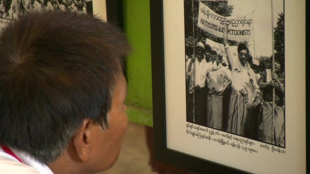 Student looks at Myanmar uprising photo