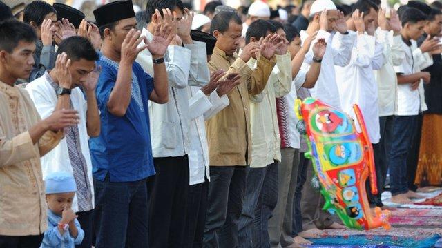 Indonesian Muslims hold Eid al-Fitr prayers in Cianjur, West Java on August 8, 2013