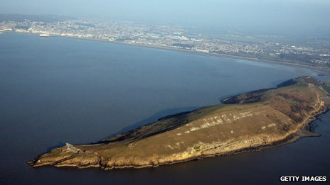 A headland juts out into the Severn Estuary