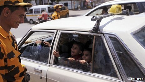 Policeman checks a taxi at a checkpoint in Sanaa 08/08/2013