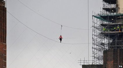 Helen Skelton walks a tightrope between two of Battersea Power Station's towers