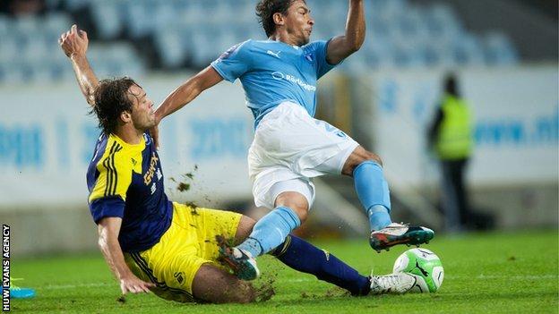 Swansea's Michu fouls Ricardinho