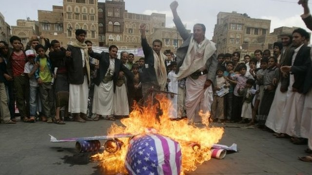 Protesters burn an effigy of a US aircraft after Friday prayers in Sanaa, Yemen, on 12 April 2013