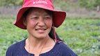 Tshering Pelden wearing a hat.
