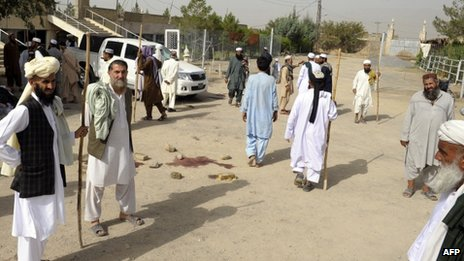 Pakistani Muslims gather at the site of an attack by gunmen in Quetta on 9 August, 2013.