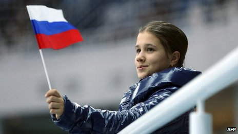 A Russian flag is waved