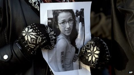 A mourner holds a photograph of Rehtaeh Parsons (April 2013)