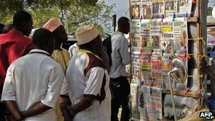 People looking at headlines in Zanzibar