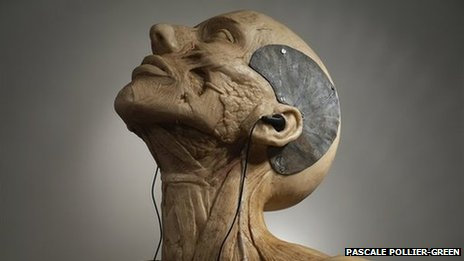 Life-sized female model made from wax ,polyester and lead with headphones