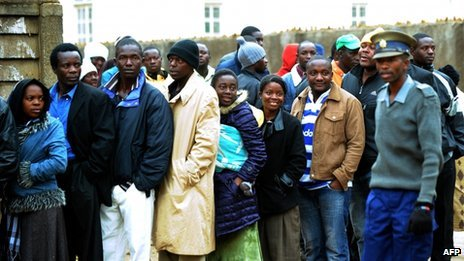 Voters queue up at the polling stations to vote in Zimbabwe's election