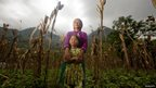 A mother and child stand in a field in northern Vietnam