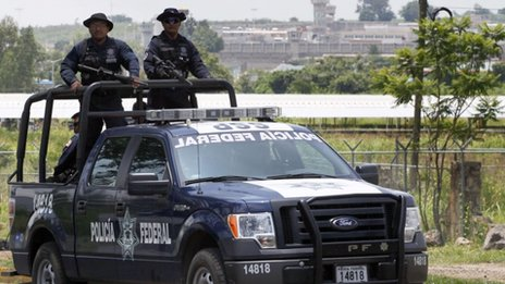 Mexican Federal Police officers patrol the surroundings of the Puente Grande State prison where former top Mexican cartel boss Rafael Caro Quintero has been imprisoned
